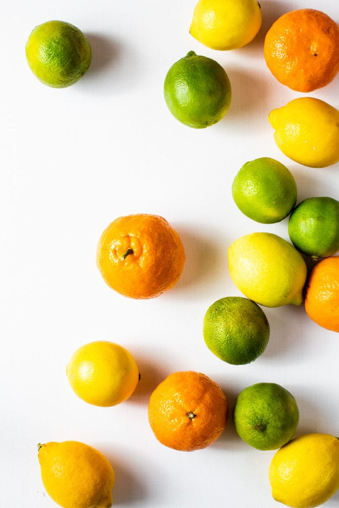 A flatly of various citrus fruits before being zested.
