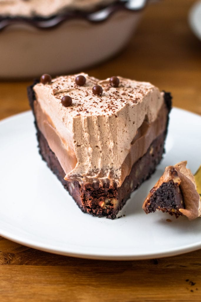 A slice of Mississippi mud pie with a bit taken out of it.
