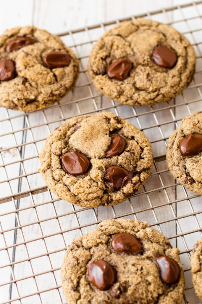 Oat flour chocolate chip cookies with buckwheat on a metal cooling rack.