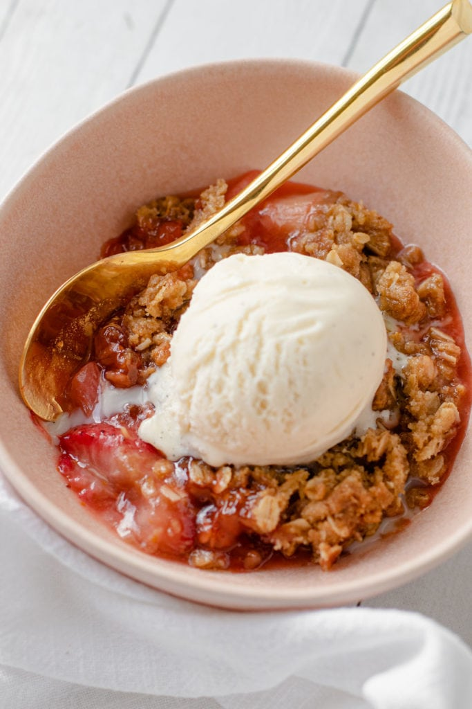 Strawberry Rhubarb Crisp with a scoop of ice cream.