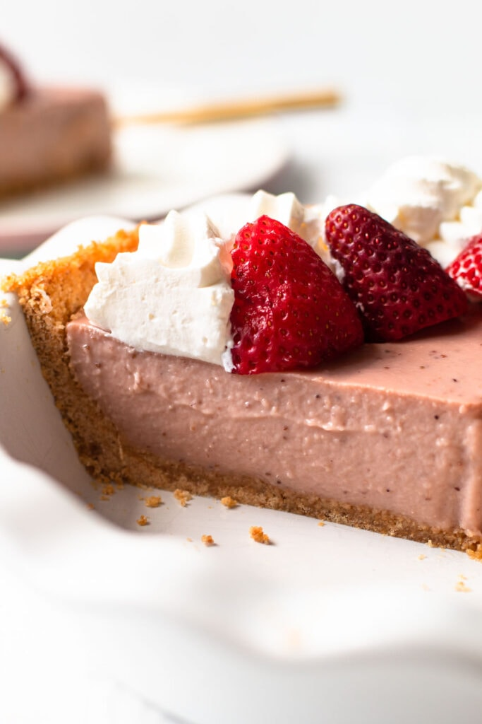 A side view of strawberry cream pie.