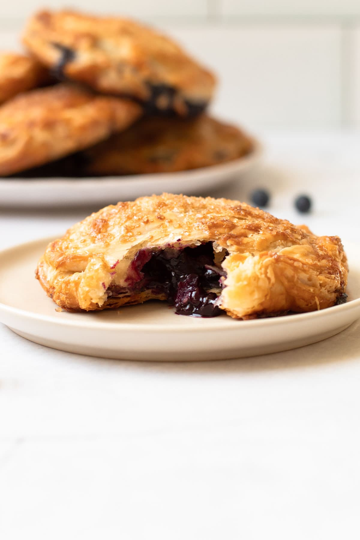 A blueberry hand pie on a plate.