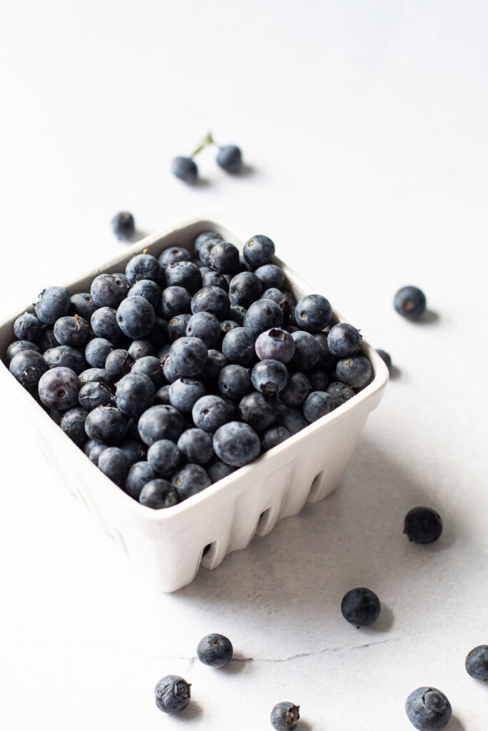 Blueberries in a ceramic container.