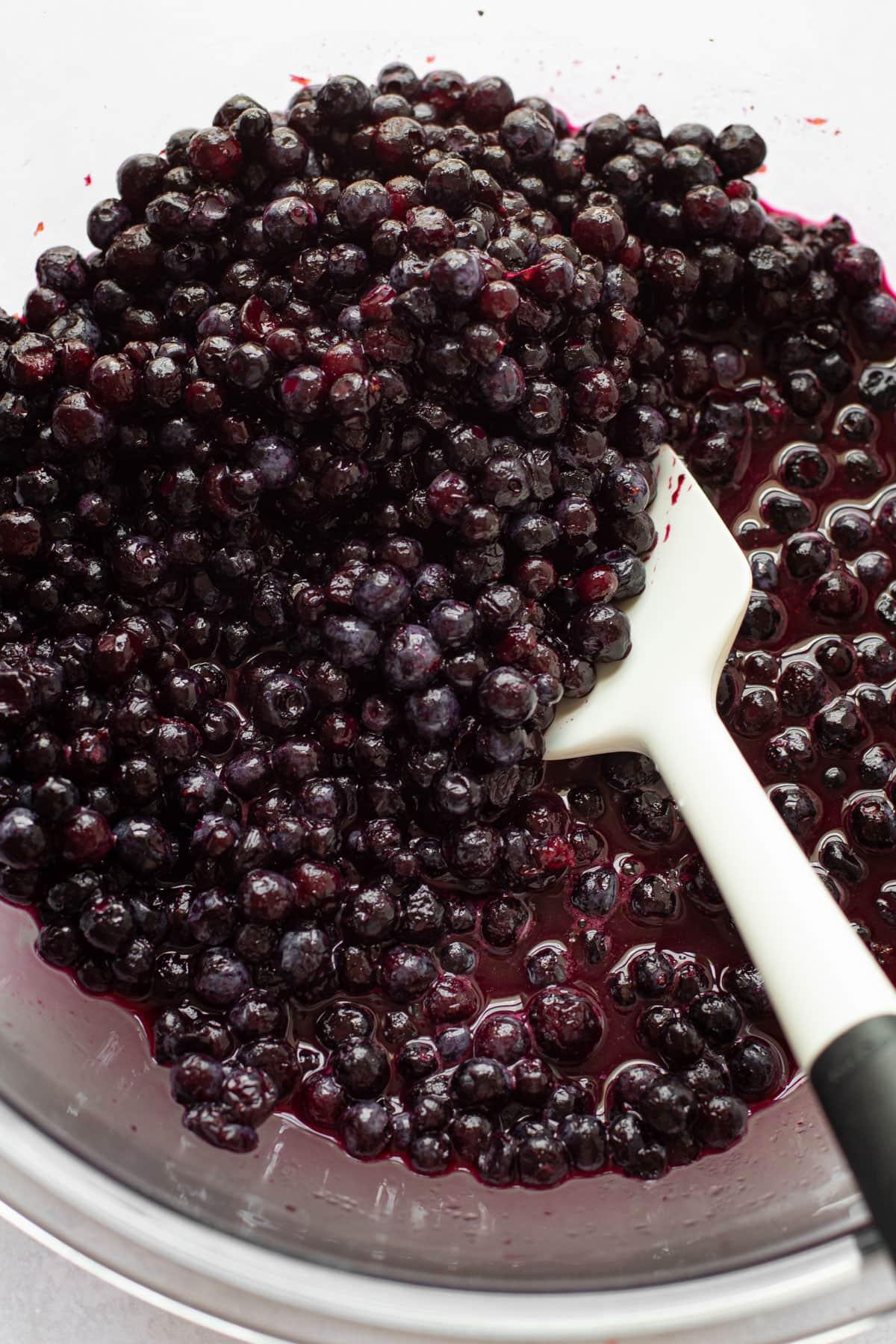 Wild blueberries being prepared to make blueberry pie filling.