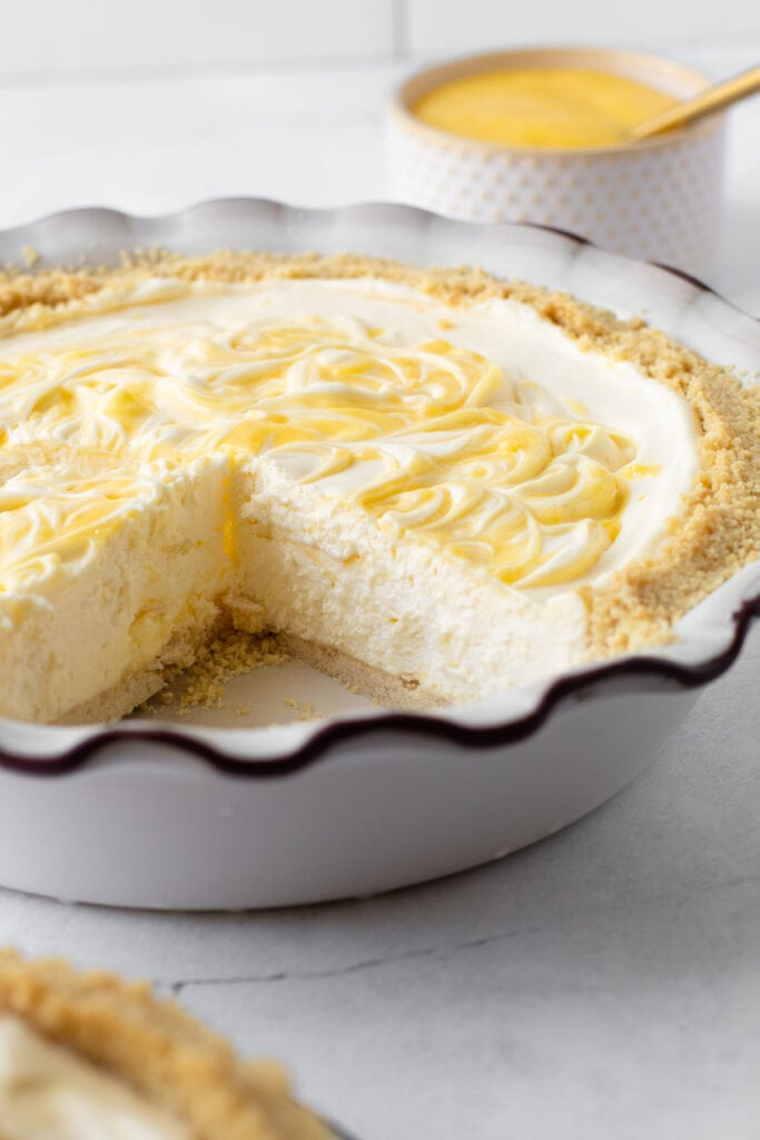 A sliced creamy lemon icebox pie.
