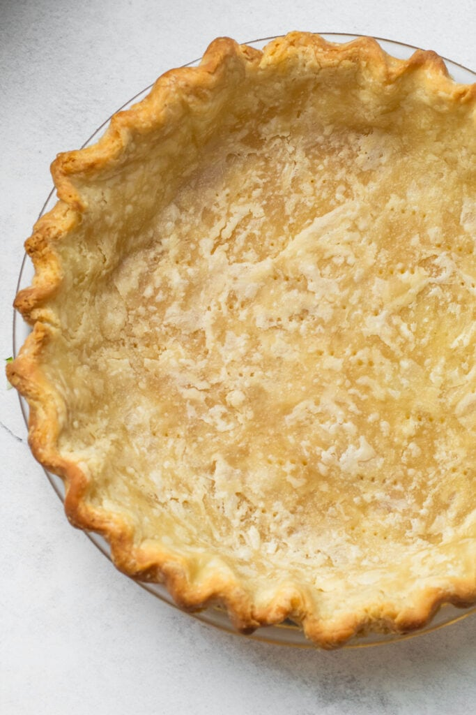 A blind baked pie crust for a zucchini pie.