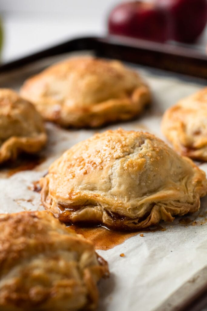 Apple hand pies on a sheet tray.