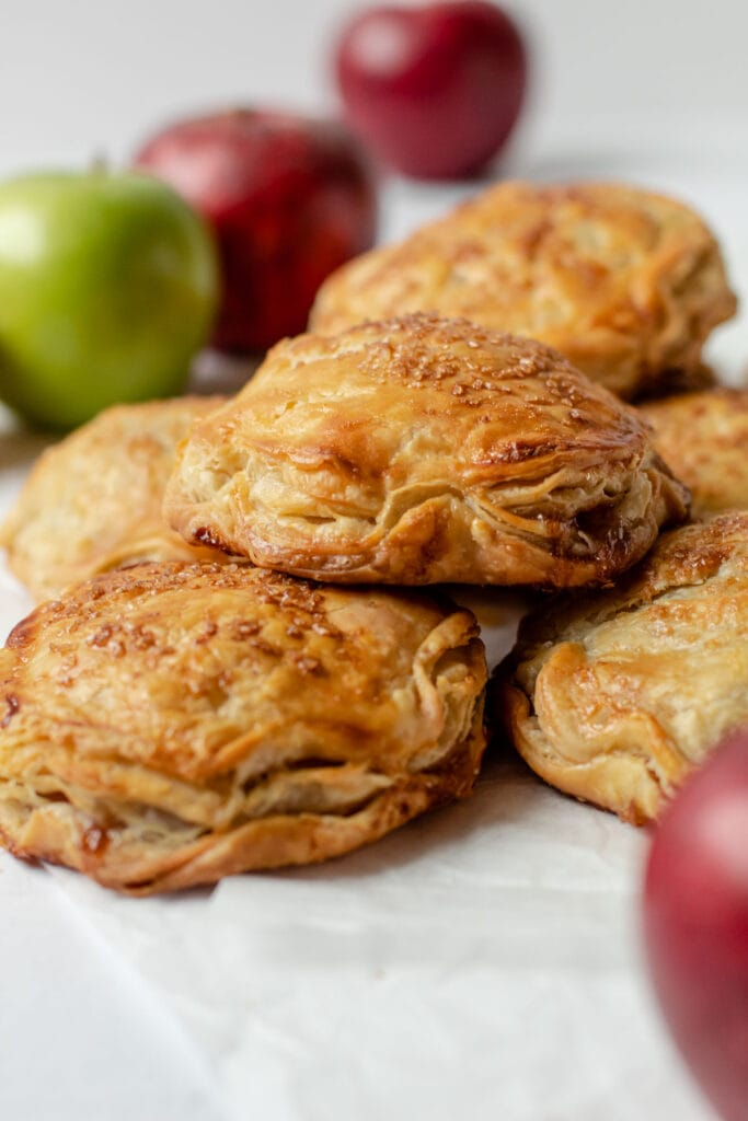 Apple hand pies stacked on top of one another.