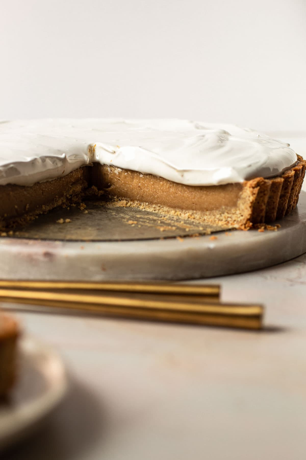 A fluffernutter pie with a slice removed to reaveal the creamy peanut butter filling.