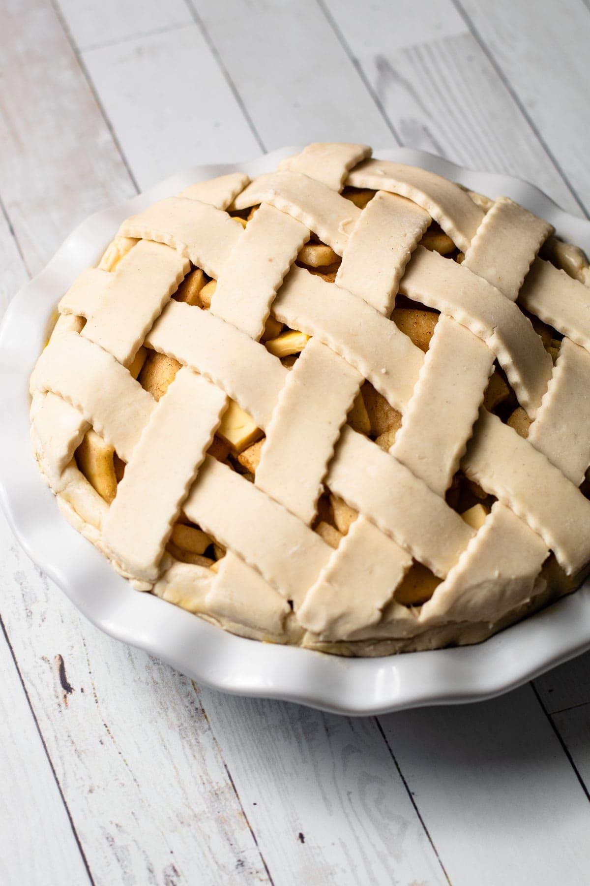A gluten free apple pie with a lattice.