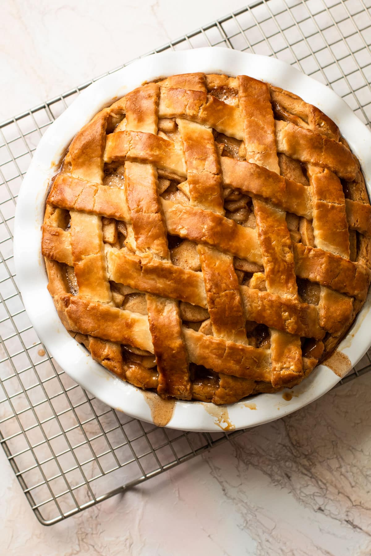 A fully baked gluten-free apple pie with a beautiful lattice.