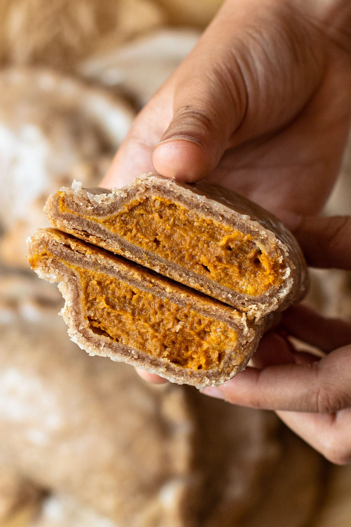 A pumpkin pasty cut in half to reveal a creamy filling.